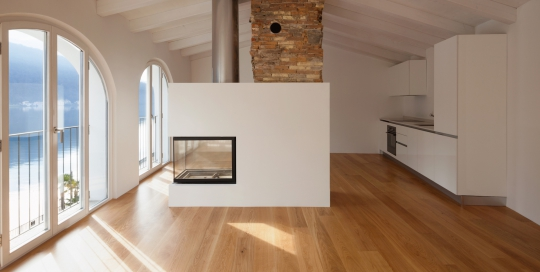 Modern renovated apartment with a large fireplace in the middle of the room which makes the ambieme more comforting